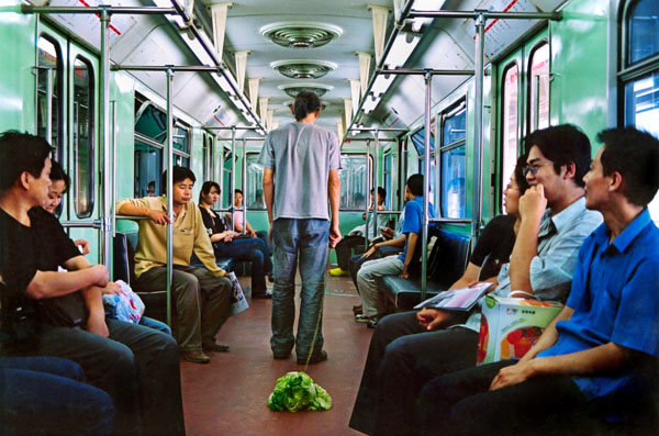 11_10-walking-the-cabbage-in-the-subway-beijing-2004wb